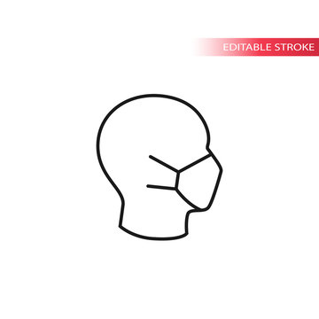 Medical mask on human head profile thin line vector icon. Editable stroke.
