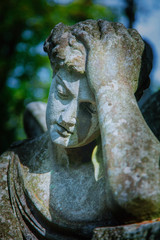 Wall Mural - Sad man on tomb as a symbol of depression, pain and sorrow. Fragment of antique stone statue.