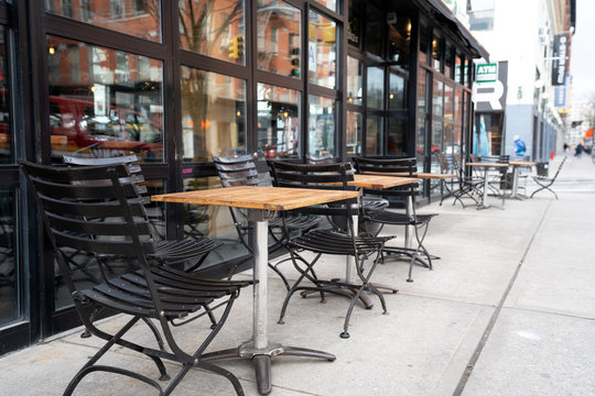 Empty tables of street cafe during New York city lockdown, coronavirus quarantine