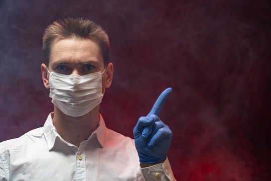 The doctor shows that it is necessary to use a respiratory mask in an epidemic. copy space