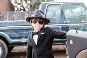 6 year old boy leaning on car open car door