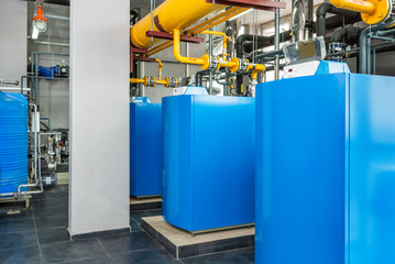 interior of an industrial gas boiler room with boilers and pipelines
