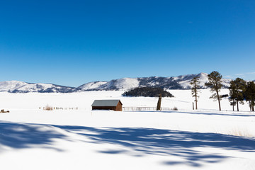 Scenic of a winter snow landscape and small cabin. ,Valle Caldrea