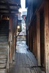 Canvas Prints Narrow alley Vertical picture of an alley between old salt cod warehouses in Bergen in Norway