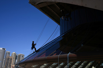 Workers clean windows on the Sydney Opera House in Sydney