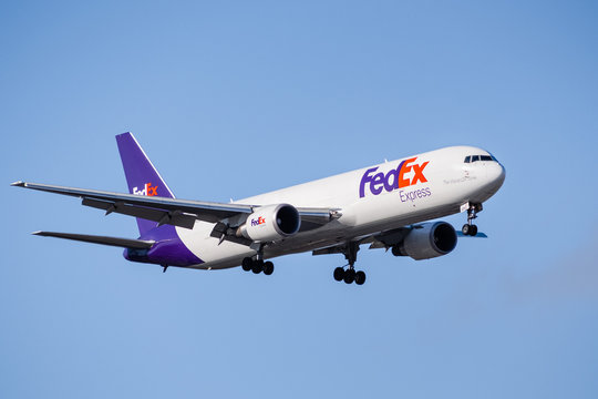 March 13, 2020 San Jose / CA / USA - FedEx Express aircraft approaching San Jose International Airport; FedEx Express is an American cargo airline, subsidiary of FedEx Corporation