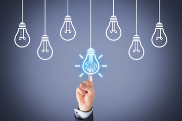 Creative Idea Concepts with Light Bulb on Visual Screen