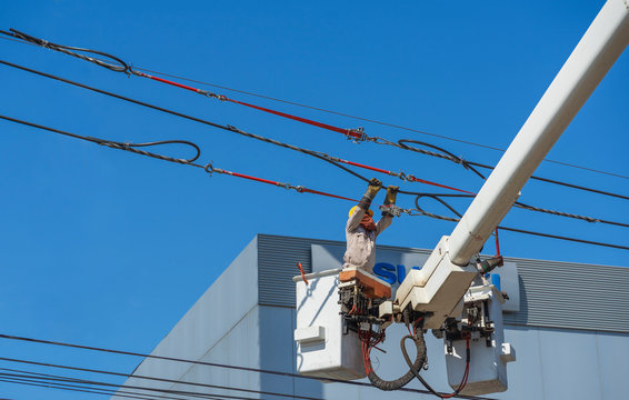 maintenance of electricians work with high voltage electricity on the hydraulic bucket