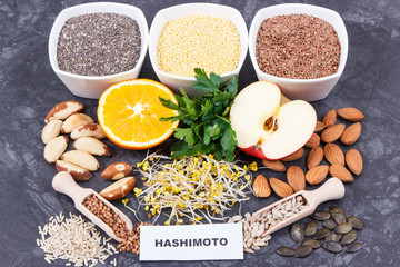 Inscription hashimoto with products and ingredients containing vitamins for healthy thyroid
