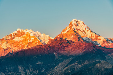 Majestic view of sunset sweeping through Annapurna South and Himchuli from Poon Hill, Ghorepani, Nepal Fototapete