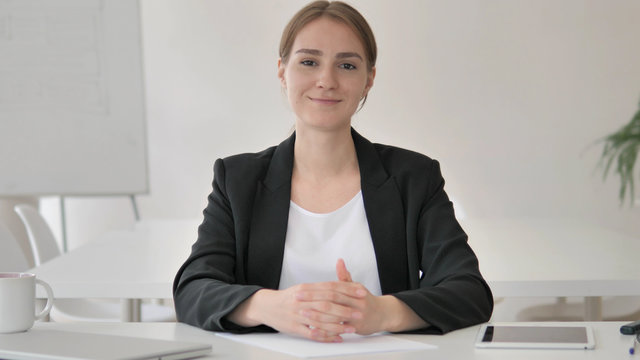Young Businesswoman Talking with Customer, Webinar