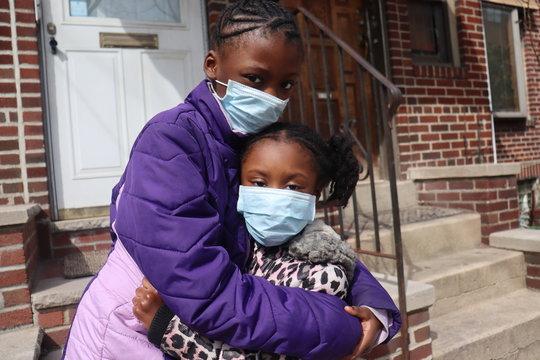 Girls wearing surgical masks
