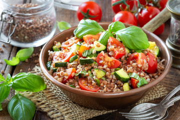 Delicious vegetarian buckwheat salad with zucchini, cherry tomatoes and fresh basil. Healthy eating and weight loss recipe