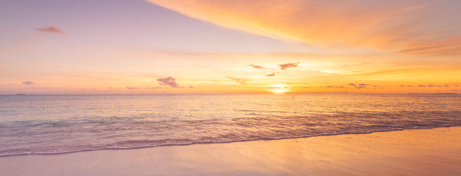 Sea sand sky concept, sunset colors clouds, horizon, panoramic background banner. Inspirational nature landscape, beautiful colors, wonderful scenery of tropical beach. Beach sunset, summer vacation