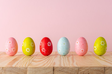 Creative composition with Easter eggs on wooden table. Minimal Easter background. Spring holidays concept.