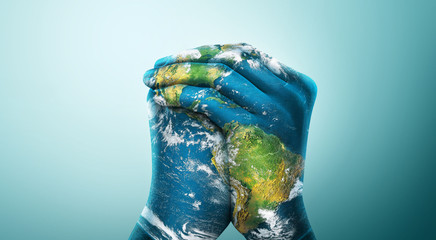 Green Planet in Your Hands. Save Earth. Environment Concept. Elements of this image furnished by NASA