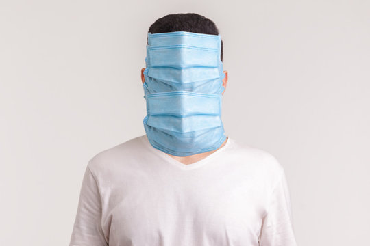 Protection against contagious disease, coronavirus. Man wearing hygienic mask to prevent infection, airborne respiratory illness