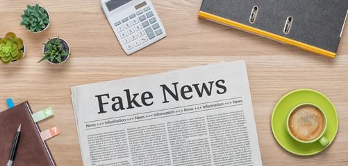 A newspaper on a desk with the headline Fake News