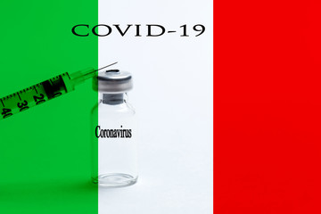 Vaccine with covid 2019 inscription on the background of the Italian flag. Earth pandemic 2020. Chinese coronovirus.