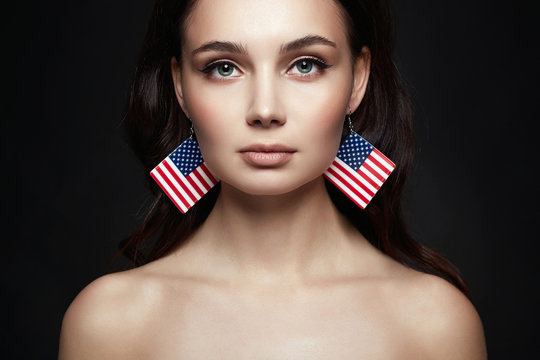 Beautiful young woman with american flag earrings