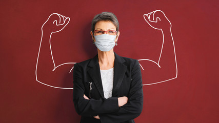 Portrait of a successful, strong business woman in protective mask