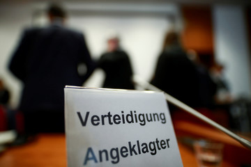 A sign is seen during a break of a trial against British banker