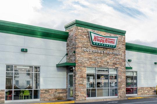Charlotte, North Carolina, USA - January 15, 2020: One of Krispy Kreme store in Charlotte, North Carolina, USA. Krispy Kreme Doughnuts, Inc. is an American doughnut company and coffeehouse chain.