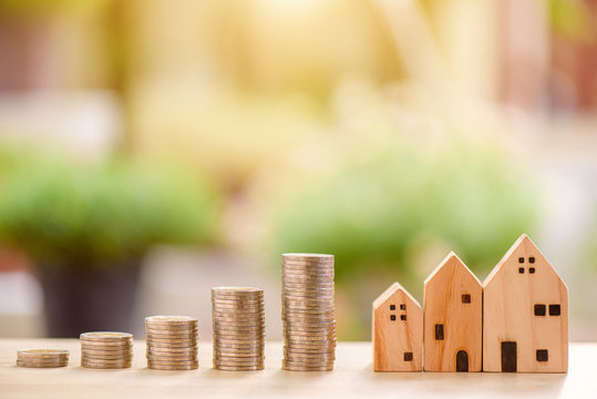 house model and wooden text loan and step of growing coins, money saving or investing for home lone or real estate concept