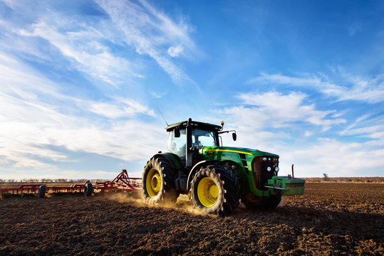Varna, Bulgaria - March 5, 2017 Ploughing a field with John Deere 6930 tractor. John Deere was manufactured in 1995-1999 and it has JD 7.6L or 8.1L 6-cyl diesel engine.