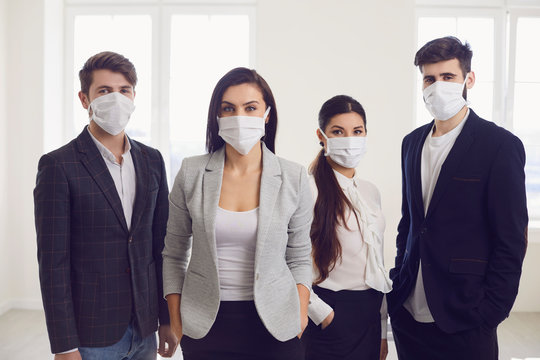 Danger of infection of the virus coronavirus infection. Group people businesspeople in medical mask at office.