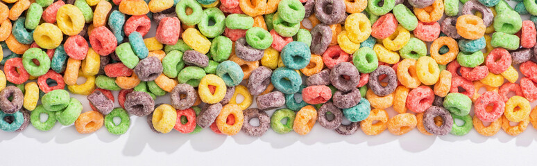 top view of bright multicolored breakfast cereal on white background, panoramic shot