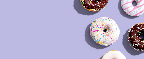 Collection of delicious donuts overhead view flat lay