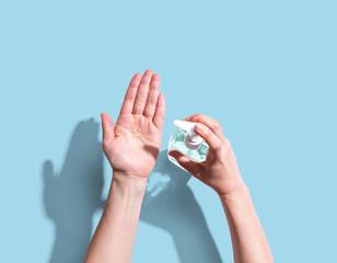 Door stickers London Applying sanitizer gel - healthcare and hygiene concept