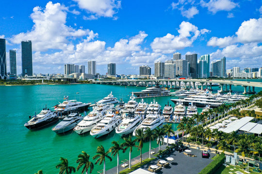 Aerial Photography of Luxury Boats and Buildings in the Background