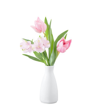 spring flowers in white vase isolated on white wooden background