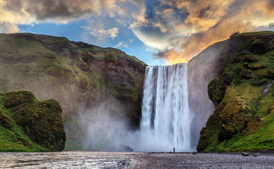 Fond de hotte en verre imprimé Marron chocolat Majestic nature of Iceland. Impressively View on Skogafoss Waterfall with colorful sky glowing sunlight, during sunrise. Skogafoss the most famous place of Iceland. creative artistic image. postcard