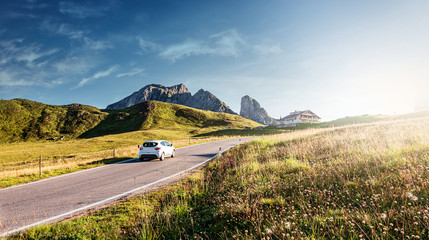 Fotomurales - Mountain road. beautiful asphalt road in the evening. Incredible summer day. Vintage toning. Highway in mountains. Pass Giau. Dolomites Alps. Italy. popular travel and hiking destination