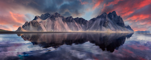 Papiers peints Europe du Nord Vestrahorn mountaine on Stokksnes cape in Iceland during sunset with reflections. Amazing Iceland nature seascape. popular tourist attraction. Best famouse travel locations. Scenic Image of Iceland