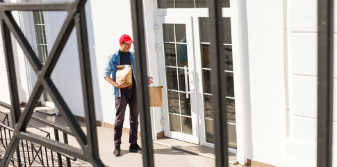 Man Delivering Online Grocery Order