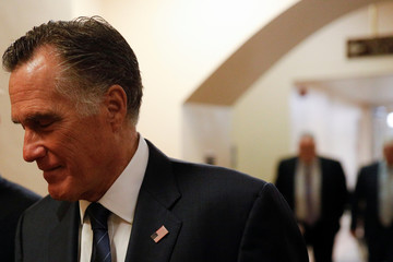 Senator Romney walks to board an elevator at the U.S. Capitol, ahead of a series of votes on response for the coronavirus disease (COVID-19), on Capitol Hill in Washington