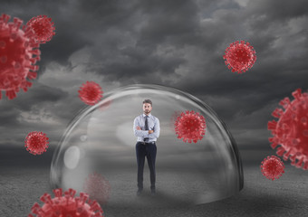 Businessman safely inside a shield dome that protects him from virus. Protection and safety concept