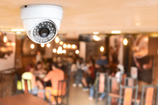 CCTV system security inside of restaurant.Surveillance camera installed on ceiling to monitor for protection customer in restaurant