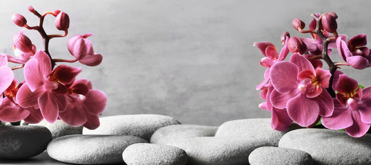 Photo sur Aluminium Spa Composition with spa stones, orchid pink flower on grey background.