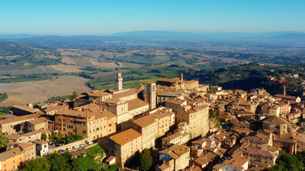 Village of Montepulciano with wonderful architecture and houses. A beautiful old town in Tuscany, Italy. Perfect for travels and vacations - aerial view with a drone