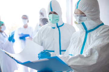 Staff in clean suits discussing a subject