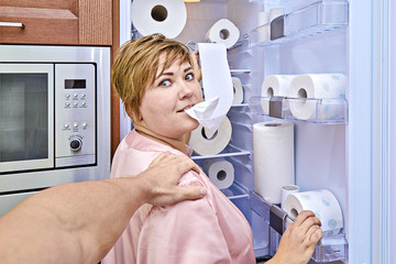 Woman with toilet paper by the refrigerator was caught her husband