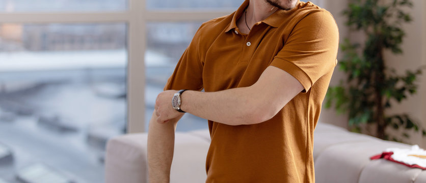 Casual man in polo blank t-shirt. Standing in live room shirt for you mockup