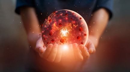 Man holding earth at night and disease contagious coronavirus or covid-19 outbreak on the world, Influenza crisis , Elements of this image furnished by NASA.