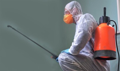 Cleaning and Disinfection in public areas amid the coronavirus epidemic. Spraying of disinfectants. Infection prevention and control of epidemic. Protective suit and mask