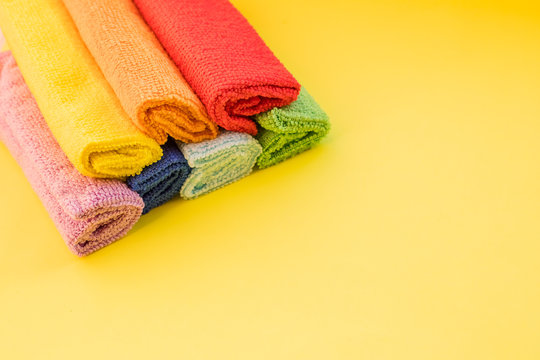 stacked colorful microfiber cleaning cloths on a white background.House cleaning products.Textile for cleaning and disinfection, for good hygiene.soft cleaning cloth.Copy space
